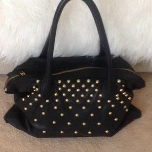 Black soft leather bag with gold studs used once.